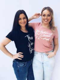 Lucy Holmes and Sharon Witt wearing a This One Life T-Shirt in a Rose colour with white text